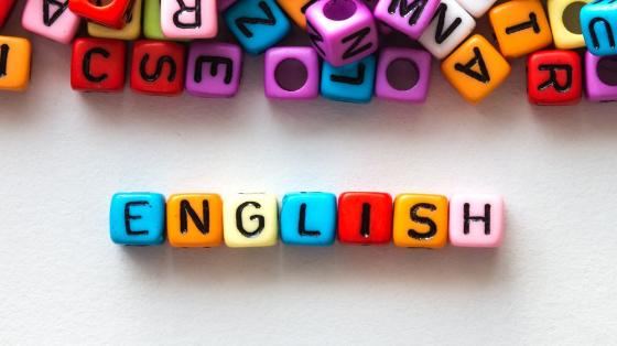 The word ENGLISH spelled using colourful square beads (photo illustration by Colourbox).