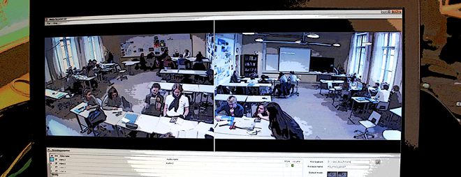A photo of a computer screen showing video footage from a classroom. Photo